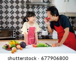 family happy in the kitchen... | Shutterstock . vector #677906800