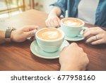 hands of couple drinking coffee ... | Shutterstock . vector #677958160