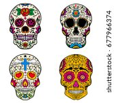 set of sugar skulls isolated on ... | Shutterstock .eps vector #677966374