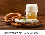 boiled white sausages  served... | Shutterstock . vector #677985490