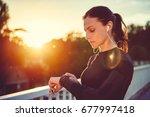 woman monitoring her progress... | Shutterstock . vector #677997418