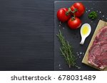 slate plate with food on black... | Shutterstock . vector #678031489