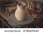 clay jug on a potter's wheel... | Shutterstock . vector #678069640