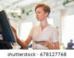 bistro worker registrating new... | Shutterstock . vector #678127768