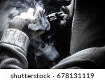 vaping man holding a mod. a...   Shutterstock . vector #678131119