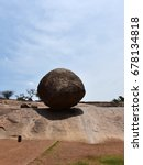 Small photo of MAHABALIPURAM, TAMIL NADU, INDIA, JULY 04, 2017: Krishna's butter ball, a huge boulder so delicately balanced on a slanting rock formation. An absolute wonder.