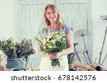 florists woman working at... | Shutterstock . vector #678142576