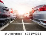 A row of new cars parked at a car dealership stock - stock photo