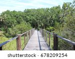 walkway surrounded by greenery  | Shutterstock . vector #678209254