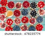 fruit and berry tartlets... | Shutterstock . vector #678235774
