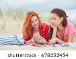 two young women laying ... | Shutterstock . vector #678252454