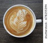 top view of a mug of latte art...   Shutterstock . vector #678255394