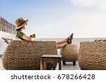 young woman sitting on hotel... | Shutterstock . vector #678266428