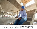 architect or builder siting on... | Shutterstock . vector #678268324