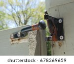 Old Rusted Black Gate Lock On...