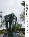 Small photo of PAY HERE SIGN WITH ARROW