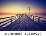 amazing sunrise on the pier at... | Shutterstock . vector #678309214