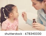asia mother give medicine to... | Shutterstock . vector #678340330