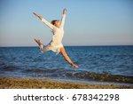 beautiful young woman jumping... | Shutterstock . vector #678342298