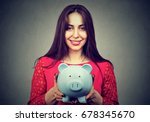 happy woman with piggy bank  | Shutterstock . vector #678345670