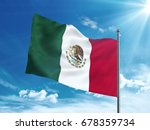 mexico flag waving in the blue... | Shutterstock . vector #678359734
