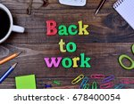 back to work on wooden table | Shutterstock . vector #678400054