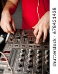 the dj's hand on the dj mixer.... | Shutterstock . vector #678421438