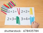 kid learning simple addition by ... | Shutterstock . vector #678435784