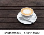 coffee cup on wood table | Shutterstock . vector #678445000