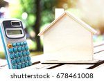 house model and calculator on... | Shutterstock . vector #678461008