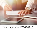 man signing documents at table. ... | Shutterstock . vector #678490210