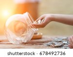 Little Girl And Pile Coin For...