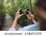 woman use phone taking nature... | Shutterstock . vector #678497299