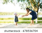 woman and daughter beach | Shutterstock . vector #678536704