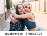 two young women hugging and... | Shutterstock . vector #678538723