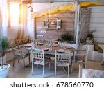 a small dining room in a rustic ... | Shutterstock . vector #678560770