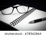 notebook glasses and pen on... | Shutterstock . vector #678562864