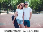 young skater boy and girl with... | Shutterstock . vector #678573103