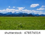 alps clouds and meadow | Shutterstock . vector #678576514