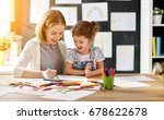 mother and child daughter draws ... | Shutterstock . vector #678622678