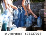water bottles being filled with ... | Shutterstock . vector #678627019