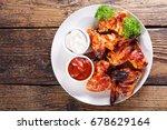 plate of fried chicken wings on ... | Shutterstock . vector #678629164