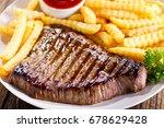 plate of grilled beef steak... | Shutterstock . vector #678629428