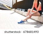 female jogger feels pain in foot   Shutterstock . vector #678681493