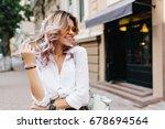 pretty girl wearing sunglasses... | Shutterstock . vector #678694564