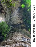 Small photo of Beautiful waterfall at the Abkhazian forest, Kodori gorge. View from bottom to top