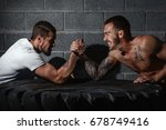 two men with hands clasped in... | Shutterstock . vector #678749416
