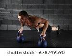 handsome muscular man doing... | Shutterstock . vector #678749590