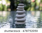 stone cairn on green blurry... | Shutterstock . vector #678752050