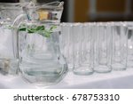 water jug with mint leaves next ... | Shutterstock . vector #678753310